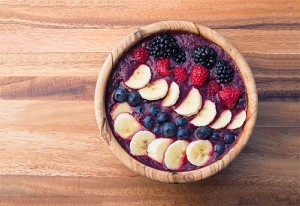 berry acai smoothie bowl with bananas, blueberries, raspberries and blackberries